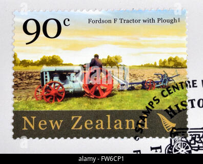 NEW ZEALAND - CIRCA 2004: stamp printed in New Zealand dedicated to historic farm equipment, shows Fordson F tractor - Stock Photo