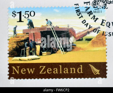 NEW ZEALAND - CIRCA 2004: A stamp printed in New Zealand dedicated to historic farm equipment, shows Threshing Mill, - Stock Photo