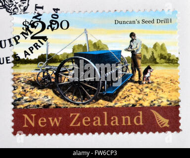 NEW ZEALAND - CIRCA 2004: A stamp printed in New Zealand dedicated to historic farm equipment, shows Duncan´s Seed - Stock Photo