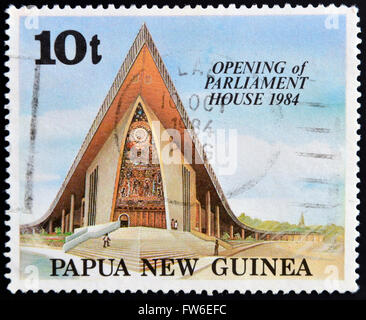 PAPUA NEW GUINEA - CIRCA 1984: A stamp printed in Papua shows opening of parliament house, circa 1984 - Stock Photo
