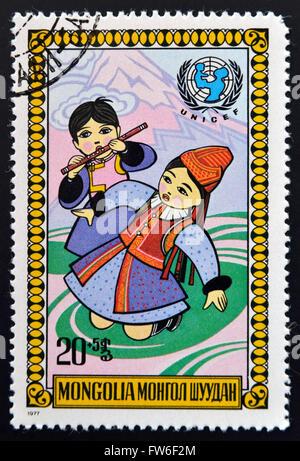 MONGOLIA - CIRCA 1977: stamp printed in Mongolia shows Girl and boy, circa 1977 - Stock Photo