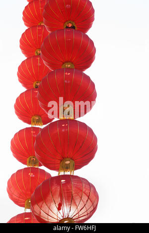 cascading chinese red lanterns against white background - Stock Photo