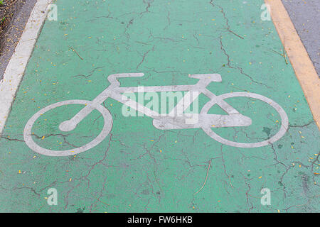Bike lane signs painted on to a green bike lane ( Bike lane, road for bicycles ) - Stock Photo