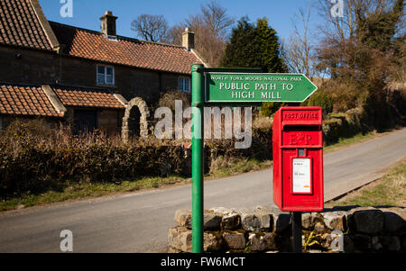 Public foot path sign and post box - Stock Photo