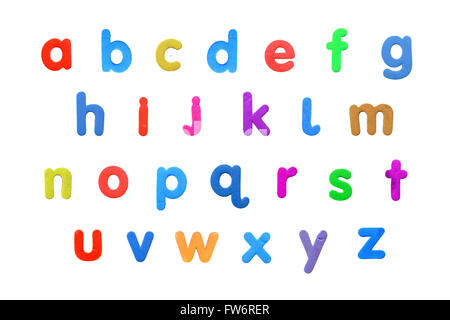 An alphabet created from fridge magnet letters against a white background. - Stock Photo