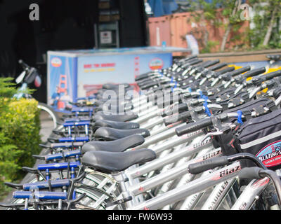 Selective focus on bicycles for rent in San Francisco's Pier 39 area, as seen from the public promenade - Stock Photo