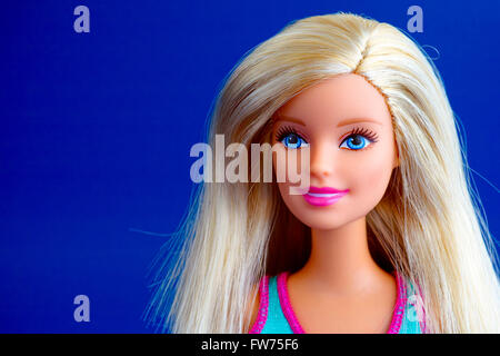 Tambov, Russian Federation - March 31, 2016 Barbie doll portrait on blue background. Studio shot. - Stock Photo