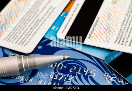 Tambov, Russian Federation - March 31, 2015 Credit cards with ballpoint pen. Studio shot. - Stock Photo