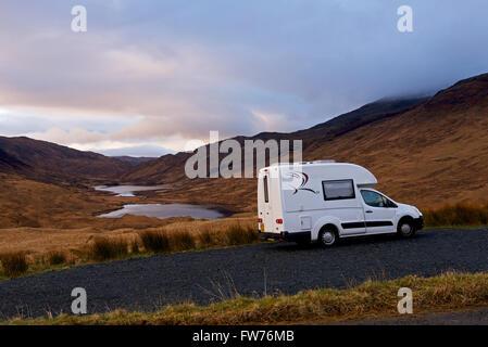 Romahome 25 parked near Loch an Eilein, Lochan Ellen and Loch Airdeglais in Glen More, Isle of Mull, Inner Hebrides, - Stock Photo