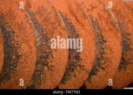 grunge background of rusted plough shares on an old cultivator - Stock Photo
