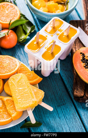 Natural juice and ingredients homemade popsicle, on wooden table - Stock Photo