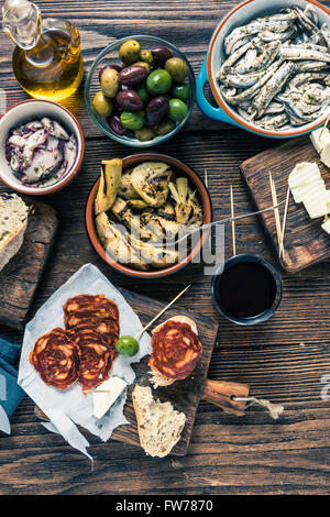 Traditional tapas served for share with friends in restaurant or bar. - Stock Photo