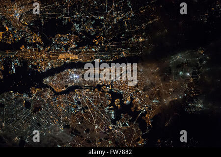 International Space Station view looking down the lights of Manhattan and New York metropolitan area at night from - Stock Photo