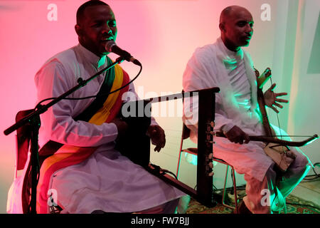 Ethiopian men playing the krar or kraar which is a five- or six-stringed bowl-shaped lyre and the masenqo also spelled - Stock Photo