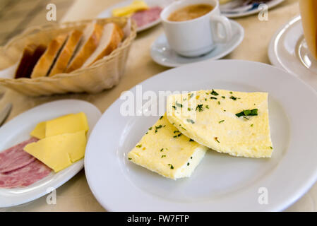 Breakfast with omelet and coffee on  table in  cafe - Stock Photo