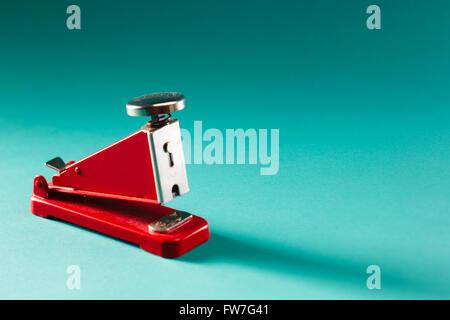 Folle stapler on mint background - Stock Photo
