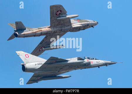 Former Swiss Air Force Dassault Mirage III DS fighter aircraft HB-RDF flying in formation with Hawker Hunter HB - Stock Photo