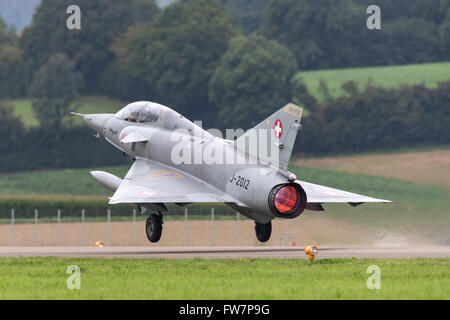 Former Swiss Air Force Dassault Mirage III DS fighter aircraft HB-RDF (J-2012) takes off with full afterburner (reheat). - Stock Photo