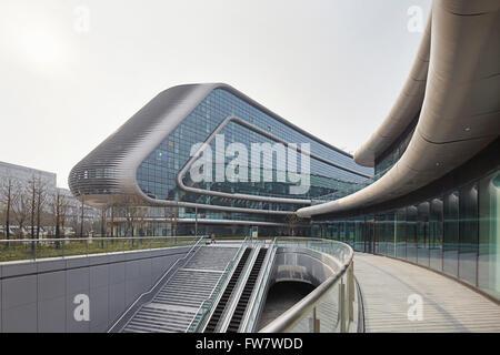 Walkway and glass curtain wall of exterior facade. Sky SOHO, Shanghai, China. Architect: Zaha Hadid Architects, - Stock Photo