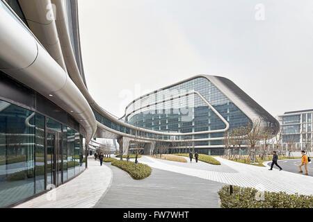 Landscaped walkways and perspective of glass curtain wall. Sky SOHO, Shanghai, China. Architect: Zaha Hadid Architects, - Stock Photo