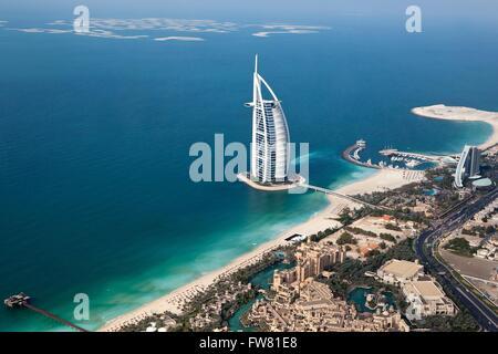 Aerial view of the luxury hotel Burj Al Arab in Dubai, United Arab Emirates. Burj Al Arab stands on an artificial - Stock Photo