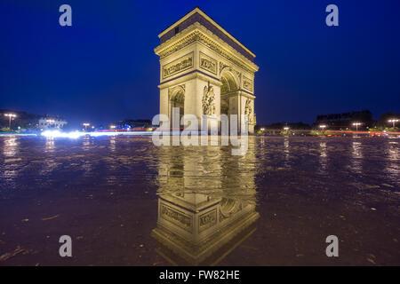 Arc de Triomphe at night - Stock Photo