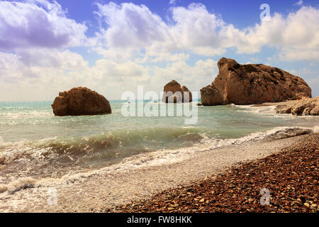 Seascape with Petra tou Romiou, also known as Aphrodite's Rock, is a sea stack in Paphos, Cyprus. - Stock Photo