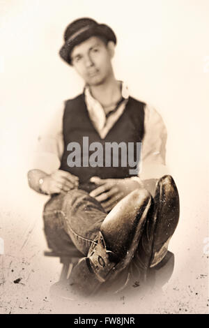 young handsome man in bowler hat - Stock Photo
