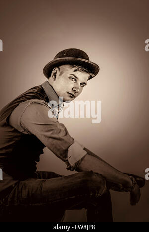 profile of young handsome man in hat sitting - Stock Photo