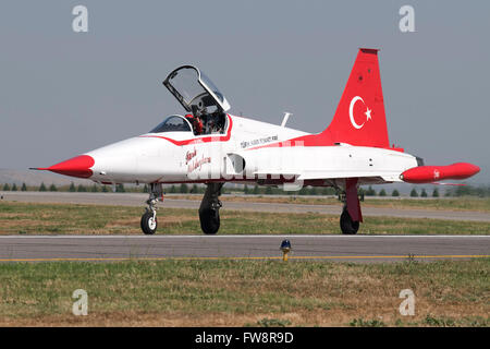 A NF-5A of the the Turkish Stars aerobatic display team taxiing at Izmir Air Station, Turkey, during the 100th Anniversary - Stock Photo