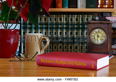 Measles, Mumps and Rubella (MMR) book title on desk, England - Stock Photo