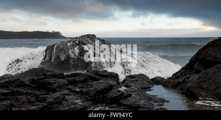Wave splashing at coast, Pettinger Point, Cox Bay, Pacific Rim National Park Reserve, Tofino, British Columbia, - Stock Photo