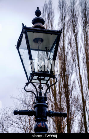 A cast iron street light with a gas lantern in Nottingham's Park Estate. - Stock Photo