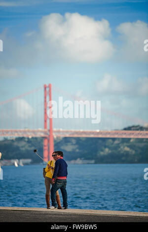Couple making a Selfie in Belem, Lisbon, Portugal - Stock Photo