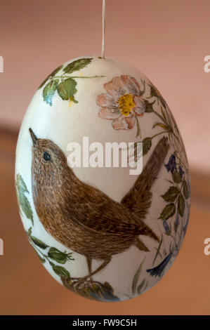 Painted duck egg with a wren (Troglodytes troglodytes) painting - Stock Photo