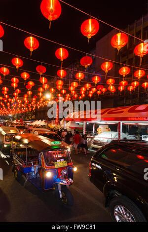 Red chinese lanterns in Yaowarat road, tuk tuks, Chinese New Year, Spring festival, Chinatown, District Samphanthawong, - Stock Photo