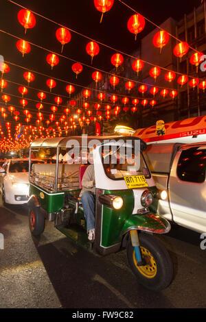 Red chinese lanterns in Yaowarat road, tuk tuk, Chinese New Year, Spring festival, Chinatown, District Samphanthawong, - Stock Photo