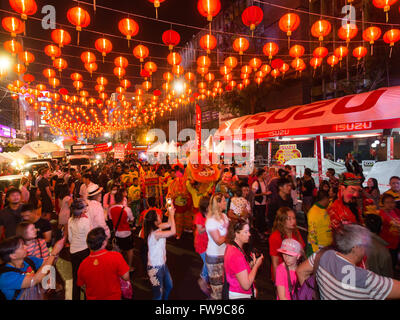 Red chinese lanterns in Yaowarat Road, dragon dance, visitors to the Chinese New Year, Spring festival, Chinatown - Stock Photo