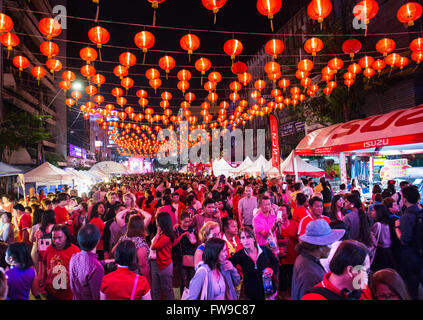 Red chinese lanterns in crowded Yaowarat Road, visitors to the Chinese New Year, Spring festival, Chinatown - Stock Photo