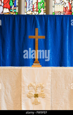 Wooden cross on the altar at St. Edward's Church, Stow on the Wold, UK. - Stock Photo