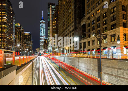 Traffic trails in downtown New York City at the entrance in Battery Park tunnel - Stock Photo