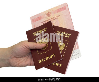 Hand with three russian passports on white background - Stock Photo