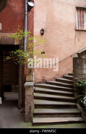Courtyard at the Long Traboule in old town Vieux Lyon, France. - Stock Photo