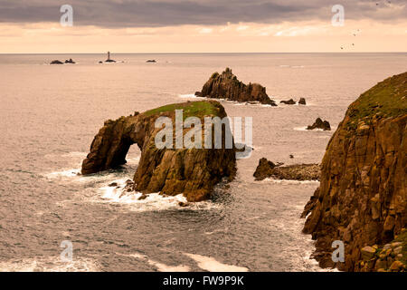 The Armed Knght and Enys Dodman sea stacks at Land's End with Longships lighthouse beyond, Cornwall, England, UK - Stock Photo