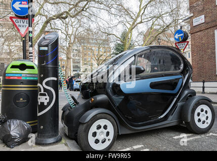 A Renault Twizy electric smart car on charge at a rapid charging point in London's Soho. - Stock Photo