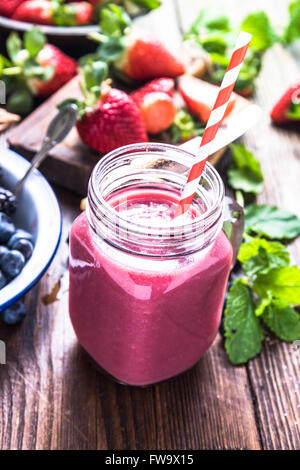 Well being and weight loss concept, berry smoothie.On wooden table with ingredients, from above. - Stock Photo