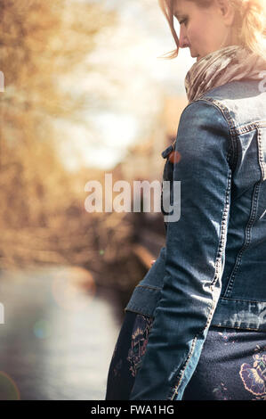 back view of the young female walking along the path - Stock Photo