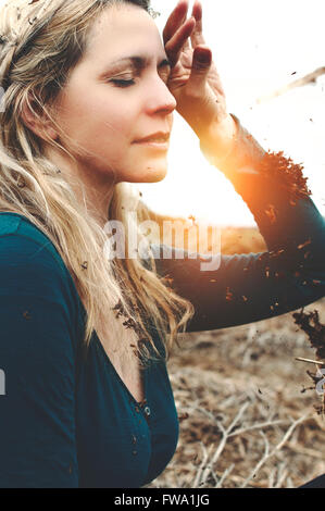 portrait of the young beautiful woman dreaming in nature Stock Photo