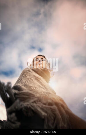 artistic portrait of the woman from below - Stock Photo