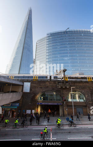 London, March 2016; The News Building and the Shard by London Bridge station. - Stock Photo